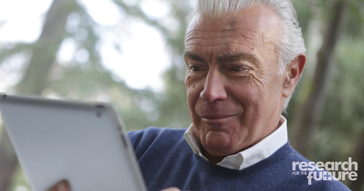man using ipad outside